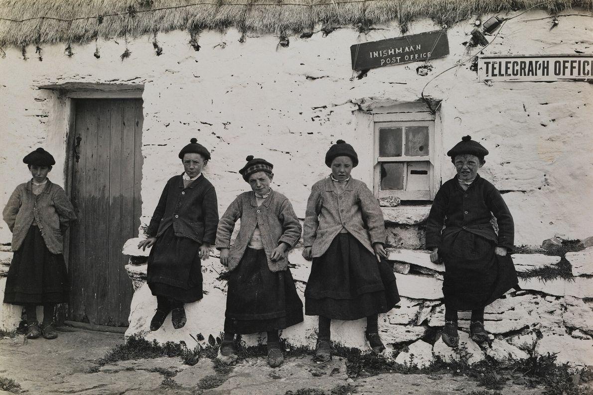 Schoolboys in 1915 are seen dressed in wool petticoats on Inishakra Island in the Aran Islands ...