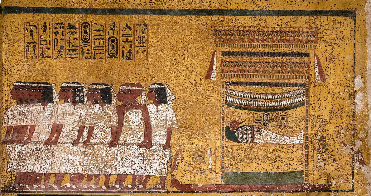 Diese Wandmalerei zeigt zwölf Männer, die den Sarg das Pharaos Tutanchamun ziehen. Die weißen Stirnbänder, die ...