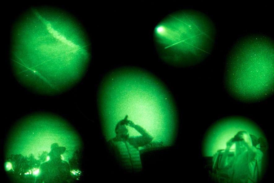 UFO believers look for suspicious spacecraft on the Sedona UFO & Vortex Tour in Sedona, Arizona. ...