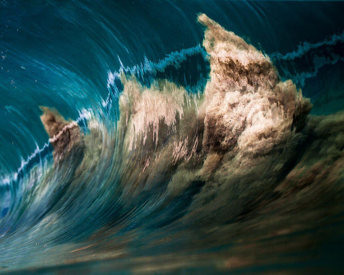 Sand in einer Meereswelle
