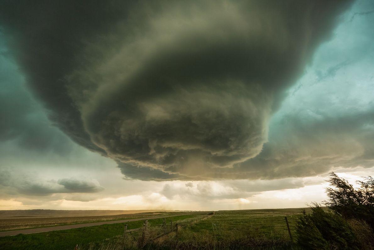 An enormous storm cloud swirls towards the ground in western Nebraska. Your Shot photographer Sean Ramsey ...
