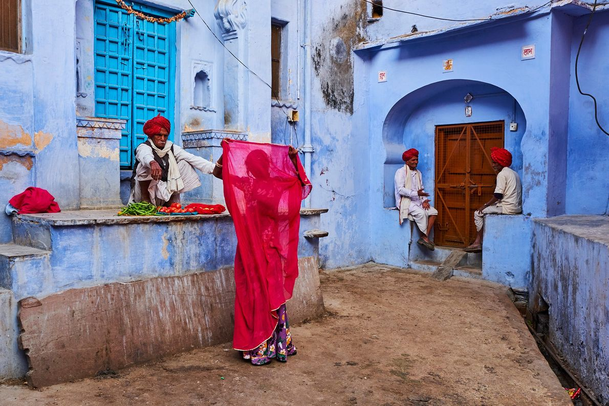 In Jodhpur, Rajasthan, a woman's crimson dupatta (shawl) contrasts with the pastel walls of the so-called ...