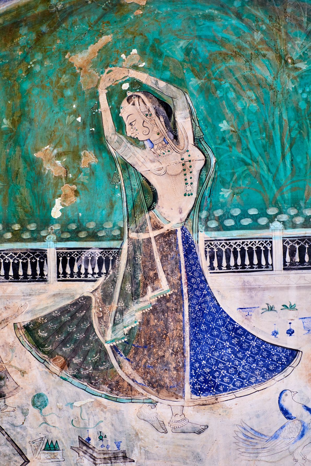 Inside Rajasthan's Garh Palace, the walls of the Chitrashala section are festooned with colorful 18th-19th century ...