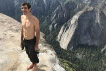 Honnold smiles atop El Capitan after his four-hour free-solo climb of the 3,000-foot granite wall. He ...