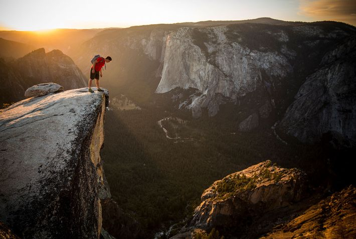 Honnold looks down from Taft Point in Yosemite National Park.