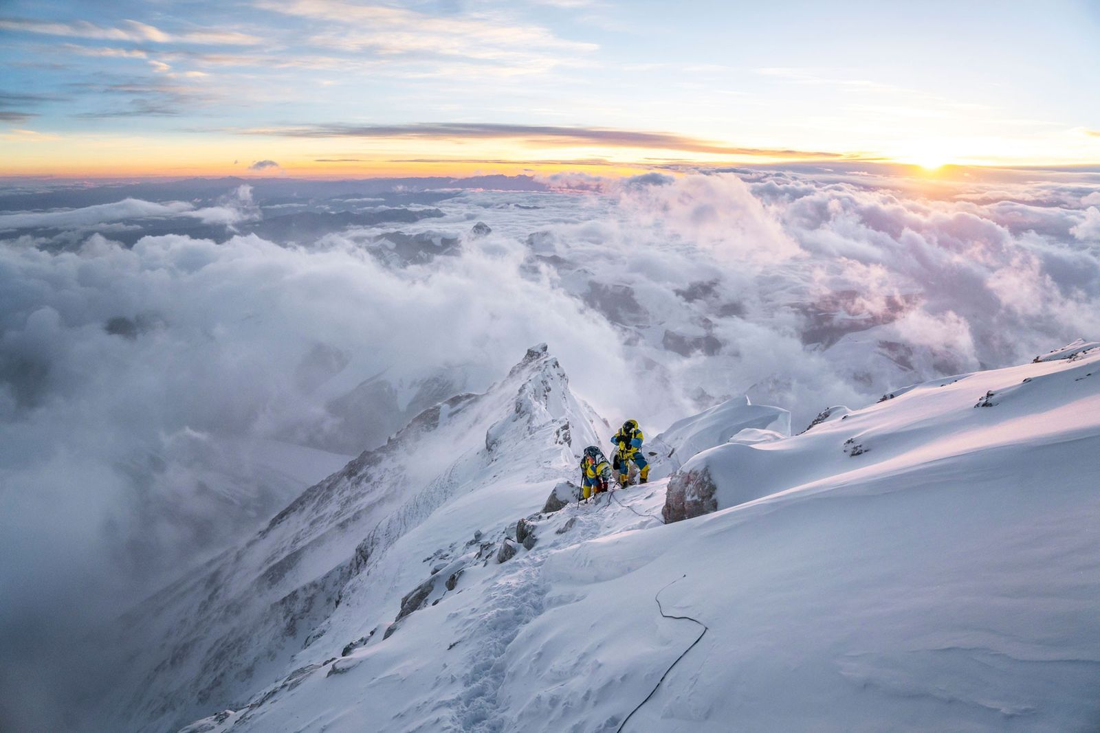 Two climbers crest the third step on the standard North Ridge route of Everest, elevation 28,000 ...