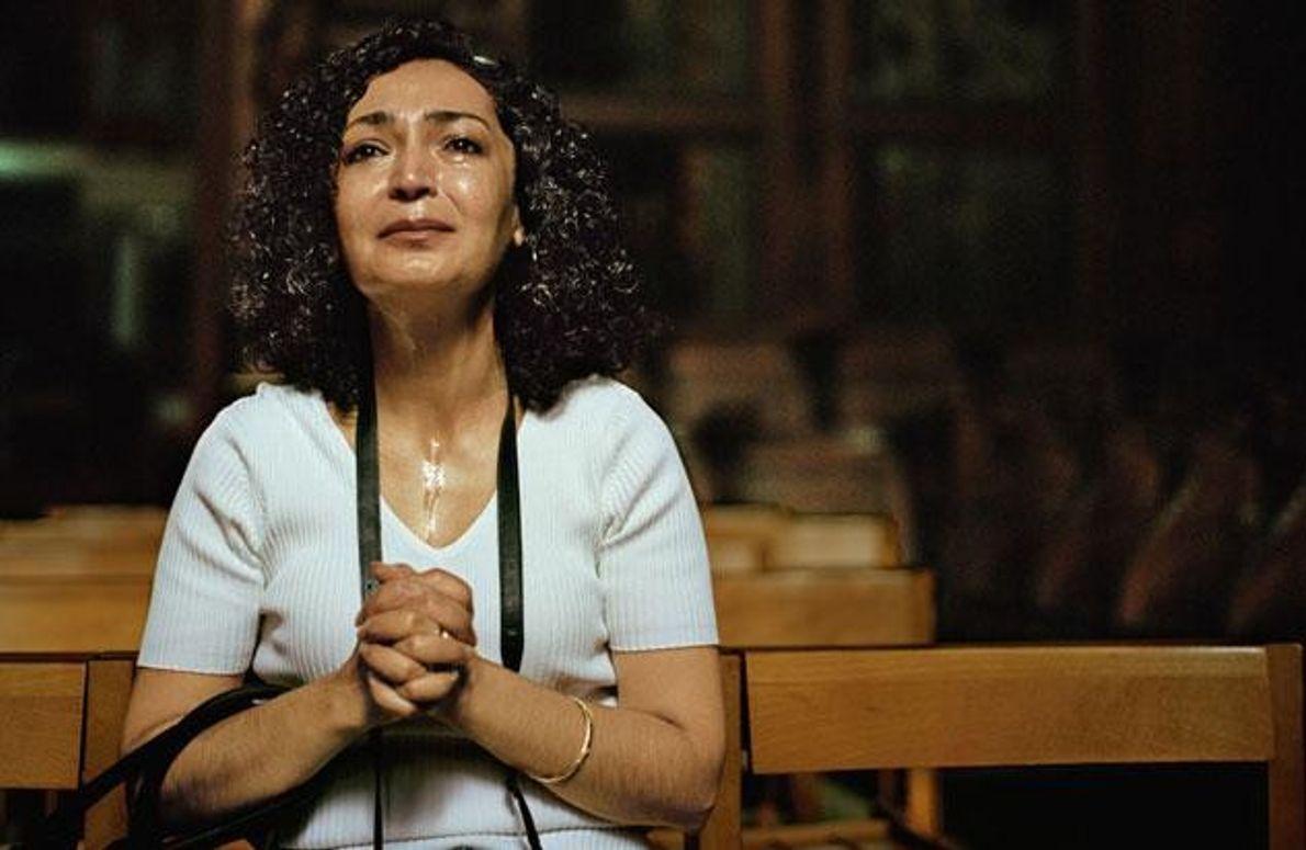 Eine betende Pilgerin