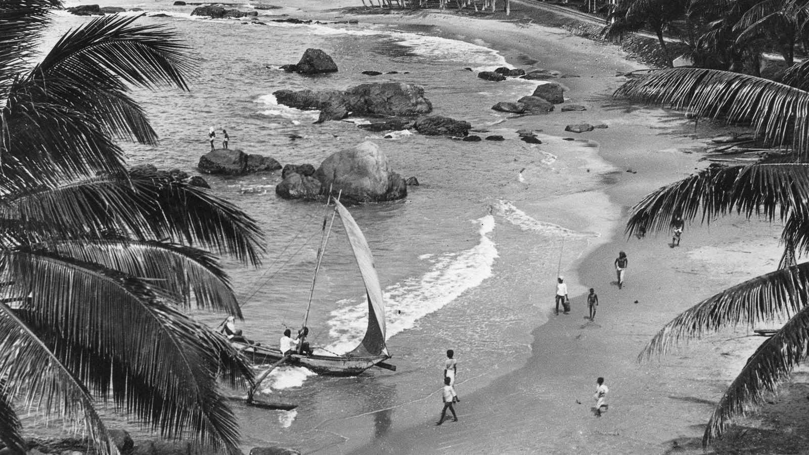 Strand mit Menschen