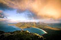Storm cloud passing by mt Amos. View towards Wineglass Bay. Freycinet Peninsula, Tasmania