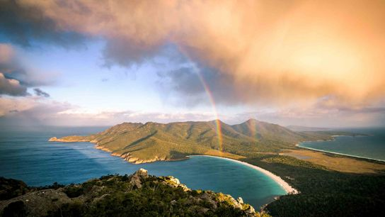 Storm cloud passing by mt Amos. View towards Wineglass Bay. Freycinet Peninsula, Tasmania