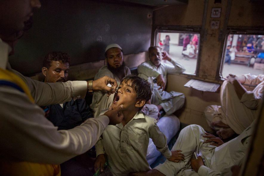Seeking out the unvaccinated in Karachi, Pakistan, a health worker finds a boy who lacks the ...