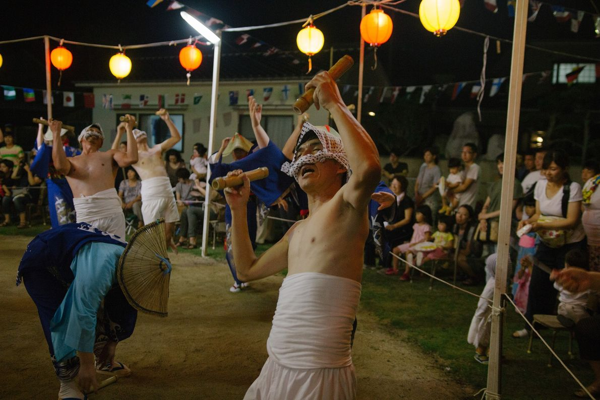 Dancers dressed as fisherman put on a performance during the Obon summer festival.