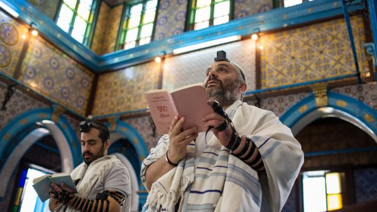 On May 14, 2017, pilgrims pray inside the Ghriba synagogue with tefillin, which are a set ...